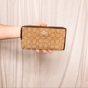 COACH brown C print large wallet